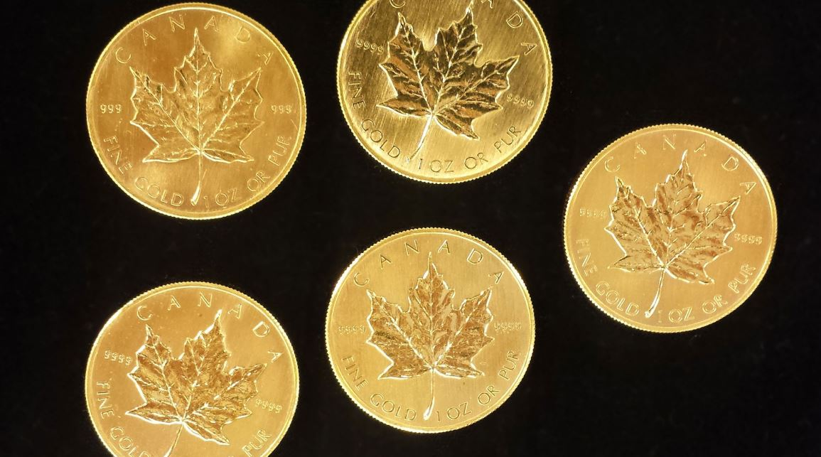 golden-canadian-maple-leaf-coins